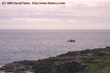 Lobster boat and the big ocean, Ogunquit, Maine, 1998-06-08.